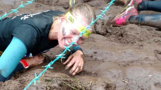 Crawling under barbed wire sporting my Total Warrior tattoo nicely!